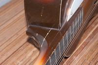 reparatie gebroken hals gitaar